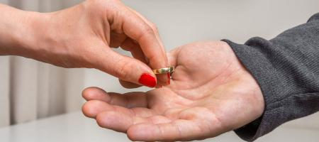 Woman giving ring back in divorce