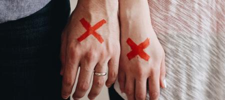 Couple in legal separation with x's on hands